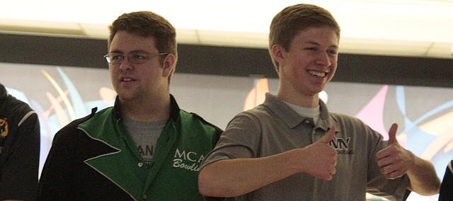 Maranatha Christian Academy senior Brett Perry, left, and Mill Valley senior Kyle Hirner, right, accept their medals at the Class 5-1A regional bowling meet on Friday at Park Lanes.
