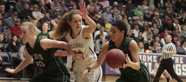 De Soto junior Linnea Searls drive to the basket with the help of a screen from Katelynn Ostronic in the first half of the Wildcats' 58-39 loss to Baldwin on Friday.
