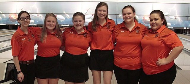 From left: Shawnee Mission Northwest bowlers Charlie Queral, Emilia Battles, Alaina Burris, Hadley Sayers, Emma Reinke and Cheyanne Bolin gather for a team photo after placing third at Monday's Class 6A regional meet to qualify for state.