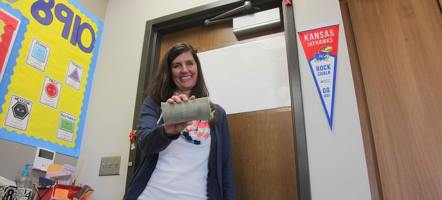 Tiffany Parker, a Tonganoxie Elementary School kindergarten teacher, holds a Safety Sleeve, a creation she came up with using repurposed fire hoses. The sleeves are designed to help keep classroom doors closed in the event of an intruder at a school.