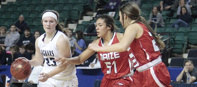 Mill Valley junior Claire Kaifes looks for a path to the basket in the first half of the Jaguars' 44-37 loss to Maize in the Class 5A girls basketball state quarterfinals on Thursday at the Kansas Expocentre in Topeka.