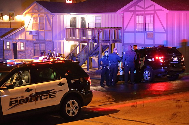 Shawnee Police investigate after someone fired shots into an occupied apartment and a parked vehicle early Sunday, March 25, at the Midland Court Apartments.