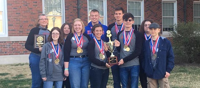 Some members of the state champion Tonganoxie High School Science Olympiad team gather after winning the small-school championship Saturday at Wichita State University. It marked the fourth straight year THS won the small-school title.