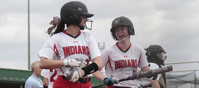 Shawnee Mission North freshman Anna Harrison, left, shares a laugh with senior Hannah Redick, right, during the Indians' 14-3 win over Shawnee Mission South on Friday at the Olathe District Activity Center.