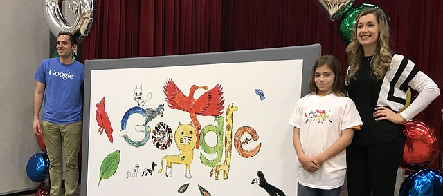 Anna Heskett stands with a giant version of her Doodle 4 Google entry. Standing with her are Google representatives Andy Makielski from Chicago and Hunter Cook, a Tonganoxie High School graduate who now works at the Google headquarters in California.