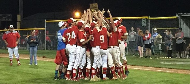 Tonganoxie High celebrates a Class 4A Division I regional title on its home field May 15, 2018, at the Leavenworth County Fairgrounds.