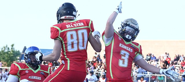 Shawnee Mission Northwest alumnus Hayden Goodpaster (80) celebrates after a touchdown catch with St. Thomas Aquinas product Drew Hicks in the second quarter of the Kansas All-Stars' 30-0 win over Missouri in the Greater Kansas City Football Coaches Association All-Star Game on Thursday at Leavenworth. Goodpaster caught the pass from Mill Valley alumnus Brody Flaming, who earned MVP honors for the Kansas team.