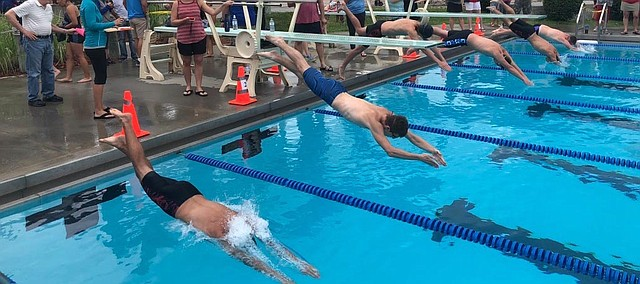 Swimmers compete Friday, June 22, 2018, at Tongie Tidal Waves meet. Tonganoxie defeated Leavenworth at Tonganoxie Water Park.