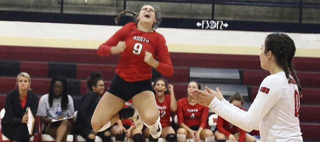 Shawnee Mission North setter Mollie Brooks celebrates after the Indians won a point in their match against Topeka High on Monday.