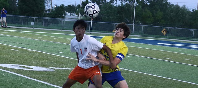 Shawnee Mission Northwest junior Tony Ramos and Olathe South senior Nick Townsend battle for possession during Tuesday's match at the College Boulevard Activity Center. The Cougars and Falcons played to a 2-2 tie.