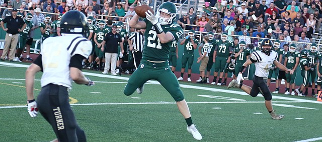 De Soto sophomore Tyson Priddy hauls in a touchdown pass from Jackson Miller in the Wildcats' 56-0 win over Turner on Friday.
