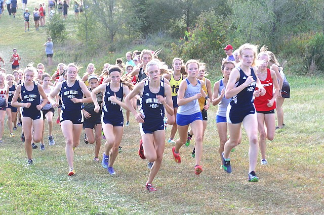 Members of the Mill Valley High School girls' cross country team run in the Mill Valley Cat Classic Wednesday at Shawnee Mission Park in Shawnee.