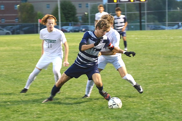 Mill Valley High School soccer senior Jake Ashford (No. 11) prepares to move upfield with the ball against Blue Valley Southwest High School Thursday night at Mill Valley High School in Shawnee.