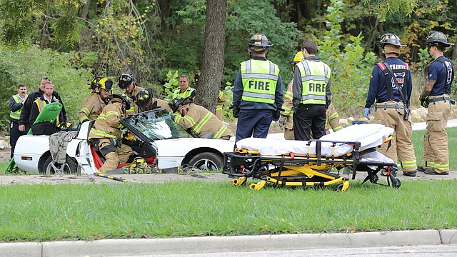 Shawnee Firefighters and Johnson County Med-Act Paramedics worked for about 25 minutes to safely remove the driver of a 1995 Chevrolet Corvette after it crashed, driver's door first, into a tree in the 13600 block of Blackfish Parkway on Wednesday.