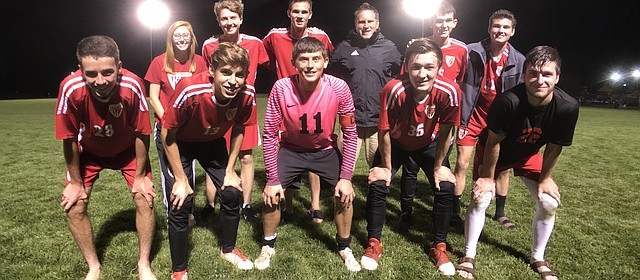 Tonganoxie High soccer seniors gather for a photo Thursday, Oct. 18, 2018, after defeating Eudora, 2-1, on Senior Night.