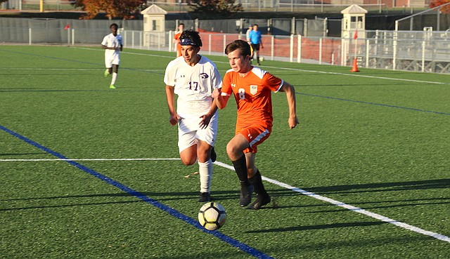 Shawnee Mission Northwest High School soccer senior Henry Fears (No. 8) dribbles towards the goal against J.C. Harmon High School Tuesday at the Shawnee Mission Athletic Complex in Overland Park.