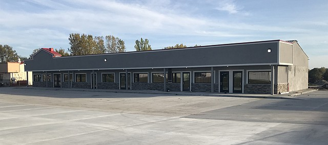 This remodeled business center along U.S. Highway 24-40 in Tonganoxie will have a ribbon-cutting Friday. Lynch Real Estate and Ferrellgas will have the ceremony at the refurbished center, which formerly was Sutton-Kolman Automotive just east of Brothers Market.