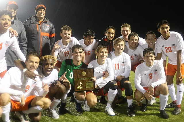 The Shawnee Mission Northwest High School boys' soccer team celebrates after defeating Olathe Northwest High School in a Regional final match Thursday night at the College Boulevard Activity Center in Olathe.