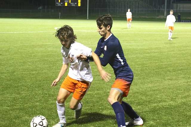 Shawnee Mission Northwest High School soccer junior Tristan Tepen (No. 17) dribbles the ball against Olathe East High School Tuesday night at the College Boulevard Activity Complex in Olathe.