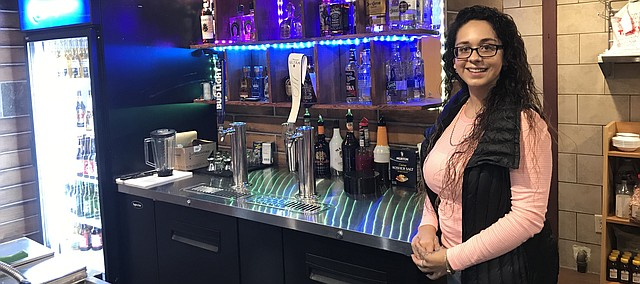 Rebeca Mier stands at the bar at Tonganoxie's newest Mexican restauarant. Ajuua! opened Oct. 22 just off East U.S. Highway 24-40.
