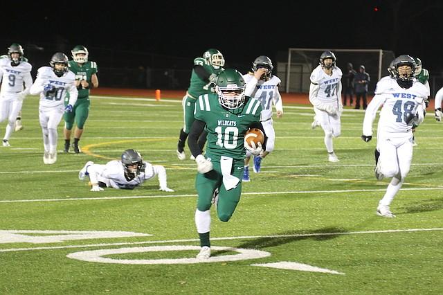 De Soto High School football senior Keegan Sturdy (No. 10) runs up the field after making a catch against Olathe West High School Nov. 9 at De Soto High School in De Soto.