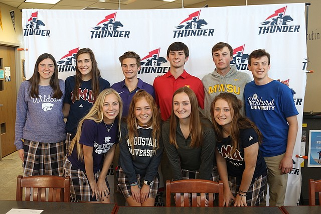 St. James Academy seniors Jake Fiscella, John Hunter, Kelly Kleekamp, Audrey Klemp, Bridget May, Page Mindedahl, Jack Moore, Jared Monk, Jackie Storm, and Caylee Thornhill pose after signing their letters of intent Wednesday at St. James Academy.