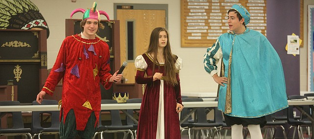 Tonganoxie High students, from left, Brendan Rogers, Lauren Lawson and Harrison York rehearse a scene Thursday for the Madrigal Feaste, which THS choir students put on Friday and Saturday at the Tonganoxie Middle School commons area.