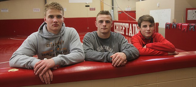Tonganoxie High wrestlers, from left, junior Connor Searcy, senior Korbin Riedel and freshman Grayson Sonntag won their respective 4A regional titles this past weekend, but all are focused on the supreme prize — a state title Saturday in Salina. Also eyeing a big weekend is senior Jesse Collier, who qualified for state with a fourth-place finish at regionals.