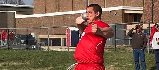 Cole Sample heaves the shot put April 1 in Ottawa. Sample set a new school record with gold-winning throw at the meet.