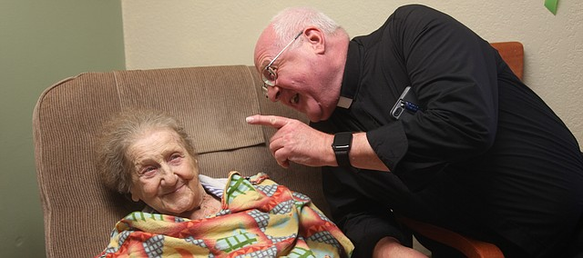 The Rev. Mark Goldasich shares a laugh with his mother, Angeline Goldasich, on Monday at Legend Healthcare in Tonganoxie. Angeline, who is a resident at Legend, turns 101 on Friday.