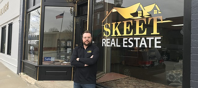 Steve Skeet stands outside his new business location in downtown Tonganoxie. Skeet Real Estate recently moved from its former location on Front Street to the 500 block of Fourth Street. Skeet updated the facade of the new building, including the light fixture above the front door.