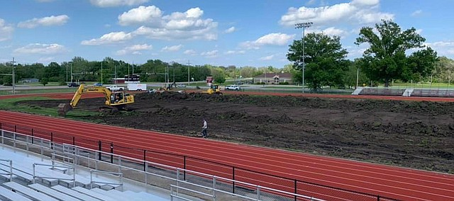 Work begins on installation of field turf at Beatty Field in Tonganoxie. The project started Monday and is expected to take 80 days at the most, weather permitting. Tonganoxie-area businesses, residents and alumni have pledged donations of nearly $300,000 so far to get the project up and going. The Turf 4 Tonganoxie comittee still is in the procss of getting pledges of just more than $100,000 for the project. The district also is contributing up to $250,000 to complement the private donations.