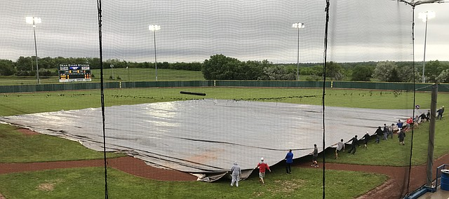A tarp covers the infield Thursday, May 23, 2019, at Dean Evans Stadium in Salina. The Class 4A state tournament is being moved to Sunday due to inclement weather. Tonganoxie will resume its quarterfinal game against Nickerson at 1 p.m. Sunday. The game was scoreless in the top of the second when lightning forced a delay. Heavy rain shortly after postponed the game further.
