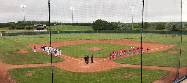 Tonganoxie High and Nickerson line up for lineup announcements Thursday, May 23, 2019, at Dean Evans Stadium in Salina.The game was called with the game still scoreless in the second inning due to lightning and then rain. The game will resume and the tournament will continue, but when that will be is still to be determined.
