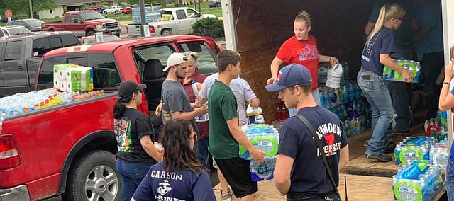 Local residents drop off supplies last week at Basehor-Linwood High School to help with Linwood tornado relief.