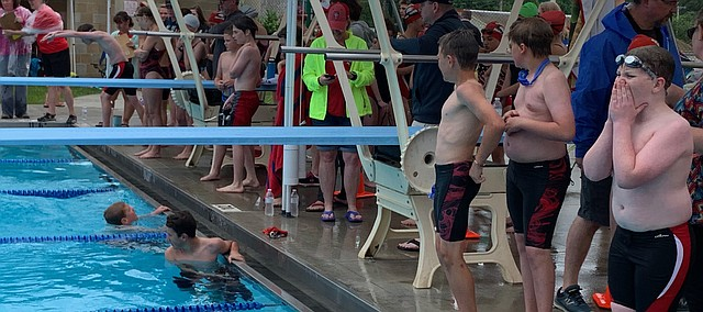 Swimmers cheer on their teammates Friday at a dual between the Tongie Tidal Waves and the Lansing Sea Lions at Tonganoxie Water Park.