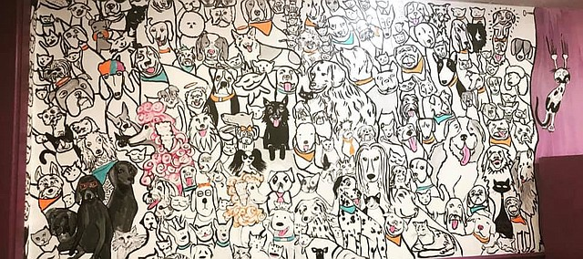 A wall inside Wizard of Paws in downtown Tonganoxie now has variety of furry faces, thanks to artist Elizabeth Daniel. The mural has around 250 pets in it, many based on actual clients, past and present, of Wizard of Paws, and others that Daniel created.