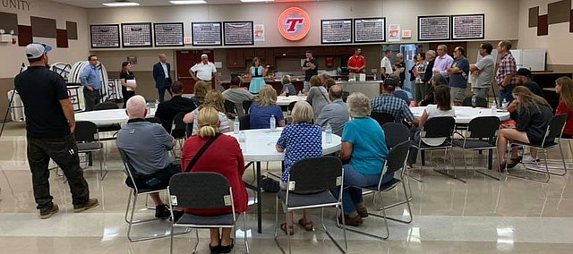 Patrons gather this past week for an informational meeting and open house for the proposed new Tonganoxie High School. The $51.4 million project will be voted on through a mail-in bond election that starts next month and will conclude in early September.
