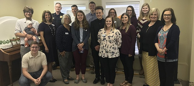 Leadership Southern Leavenworth County celebrates its 2018-19 class with a graduation luncheon May 1 at Lynnmark Mercantile in Basehor. Pictured, from left, are, Cooper Arnold (holding daughter, Wilder), Anthony Malleck, Molly Johnson, police Lt. Brandon Marshall, Janette Labbee-Holdeman, Tonganoxie Fire Chief John Zimbelman, Annelise Holland, Blake Philips, Nathaniel Baker, Katy Torneden, Jami Angell-Burke, Morgan Lackner (certificate of participation), Kathleen Boyd Bullock, Shawna Kirk, Mollie Hill and Wendy Dedeke. Not pictured is fellow graduate Debbie Adair and Mackenzie Bizzell, who received a participation certificate.
