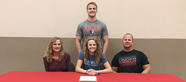 Corinn Searcy signs a National Letter of Intent to compete in track at Washburn University in Topeka. The May Tonganoxie High School graduate was a standout for THS track.