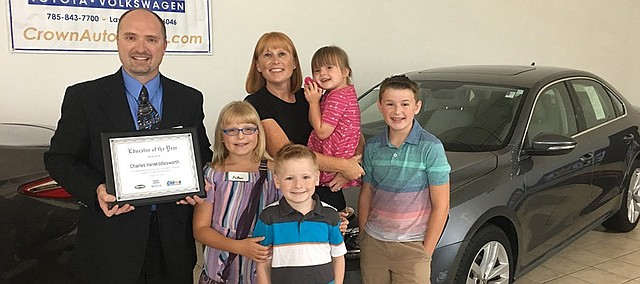 Tonganoxie High School music director Charles Van Middlesworth celebrates his teaching award at Crown Automotive in Lawrence. Crown, Minsky's Pizza and Midco Sports Network recently announced that Van Middlesworth won their 2018-19 Educator of the Year award. Pictured with Van Middlesworth is his wife, Kristan, and children Aiden, 13, Piatyn, 10, Declan, 7, and Daigen, 4. As part of his award, Van Middlesworth received $1,000 for himself and another $1,000 for THS. He also gets to drive a 2018 Volkswagen Passat for a year.