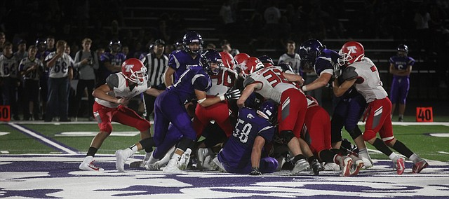 Tonganoxie and Louisburg battle at the line of scrimmage during a play Friday at Wildcat Stadium in Louisburg. Tonganoxie won, 42-6, against the defending Frontier League champions.