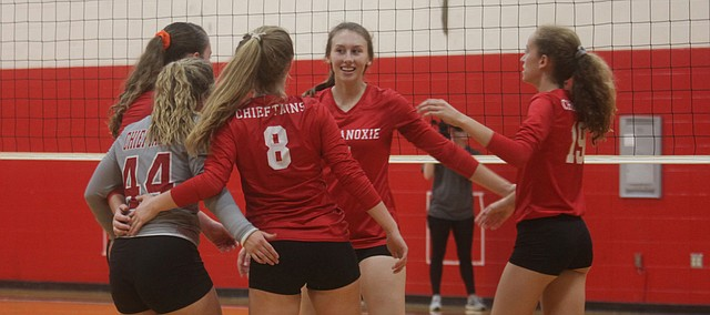 Tonganoxie High volleyball players react to scoring a point Saturday against Ottawa at the Tonganoxie Invitational. THS finished in sixth place at its home tournament.