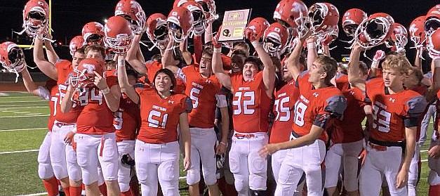 Tonganoxie High football players celebrate after defeating Spring Hill on Friday and becoming district champions. The 10-0 Chieftains now gear up for a clash with five-time defending state champion Bishop Miege this Friday at Beatty Field.
