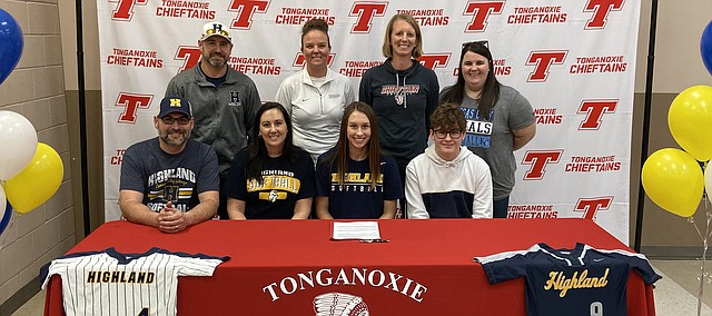 Lauren Gray celebrates her signing day with family, coaches and future coaches recently at the Chieftain Room on the Tonganoxie High School campus. Gray, a three-sport student-athlete at Tonganoxie, signed with Highland Community College. Pictured, front row, from left, are parents Chris Gray, Shelly Gray, Lauren, and Lauren's brother, Dylan Gray; back row, from left, are HCC assistant coach Scott Jordan, HCC head coach Heidi Jordan, THS head coach Stephanie Witt, and THS assistant coach Amanda Albert.