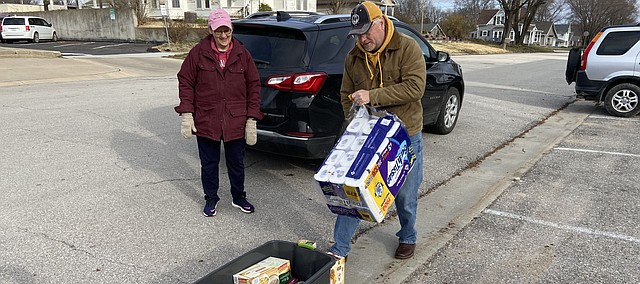 Dennis Shelton drops off some toilet paper at a food and supplies drive Friday in downtown Tonganoxie. Tonganoxie Mayor David Frese organized the drive with other volunteers for the Good Shepherd Food Bank. Items also were accepted at Brothers Market and Tonganoxie United Methodist Church. Good Shepherd officials say the drive helped with several needs, but still could especially use handsoap and jelly at this time.