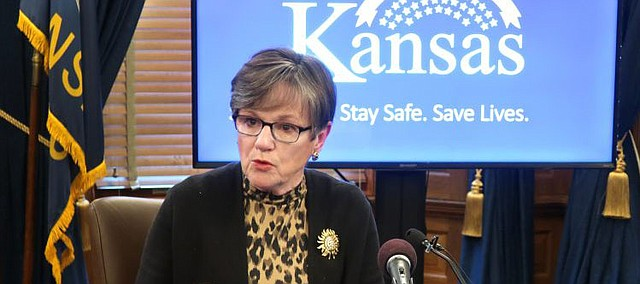 Kansas Gov. Laura Kelly answers questions about the state's response to the coronavirus pandemic during a news conference, Wednesday, April 15, 2020, at the Statehouse in Topeka, Kan. (AP Photo/John Hanna)