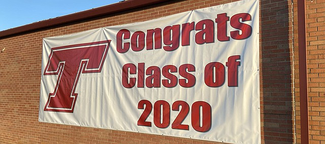If this were a normal school year, Tonganoxie High seniors would be preparing for commencement exercises later this month. This year, graduation celebrations will be done differntly due to the COVID-19 pandemic. This banner, installed this past week, can be seen as people drive by Tonganoxie High School's east campus building.