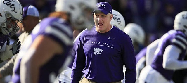 Kansas State football coach Chris Klieman with his players before the Wildcats take on West Virginia during the 2019 season.