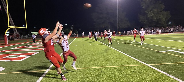 Tonganoxie High's Dallas Bond hauls in an apparent touchdown pass Friday against Eudora, but it was called back due to an illegal player downfield penalty. THS won the game, 52-30.
